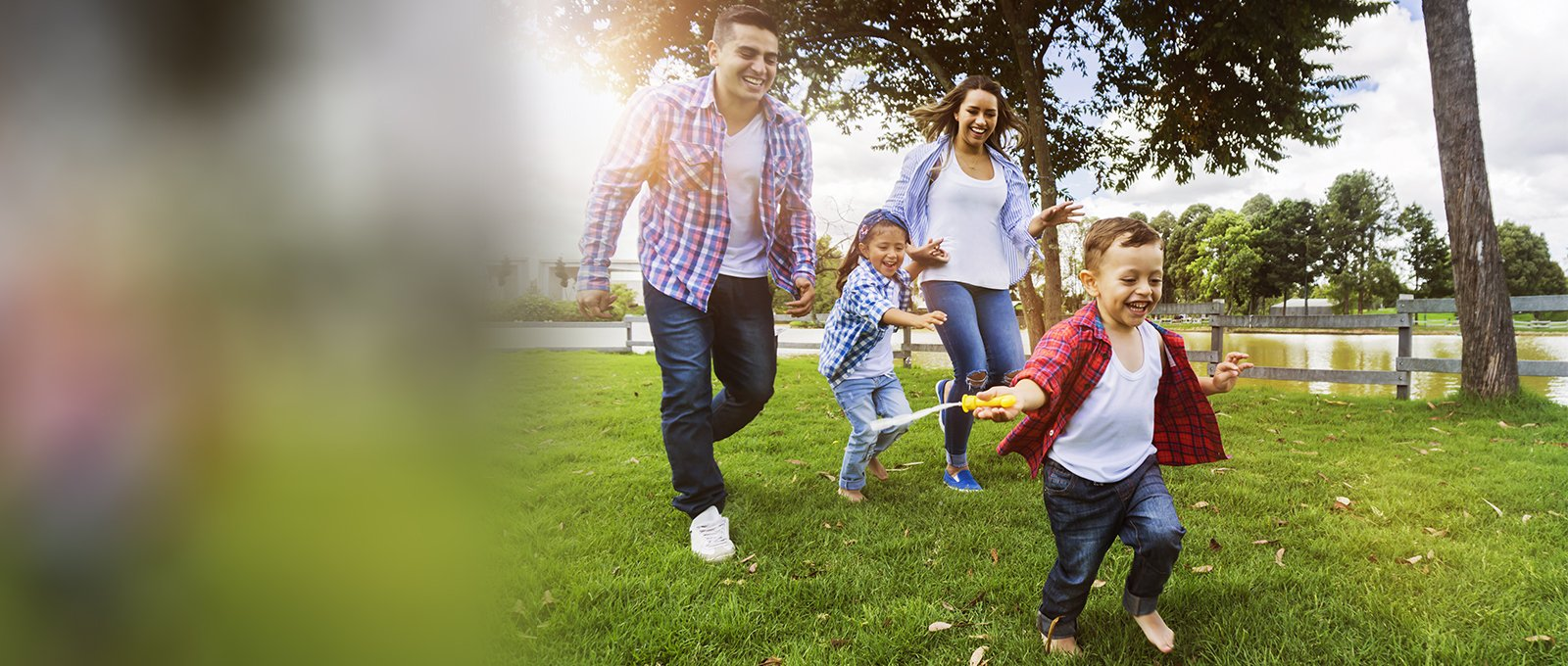 Image of active healthy family playing in the park