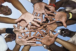 Hands in a team huddle