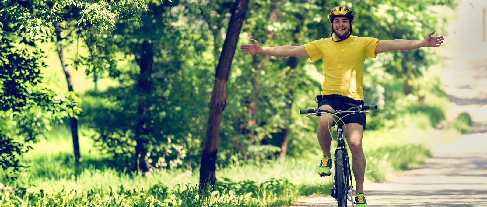 Photo of man riding bike on sunny day